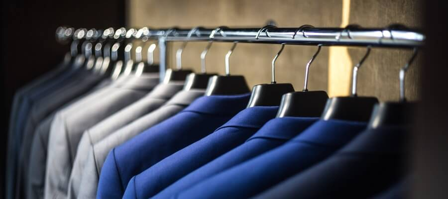 Wardrobe with dark, grey and blue man suits