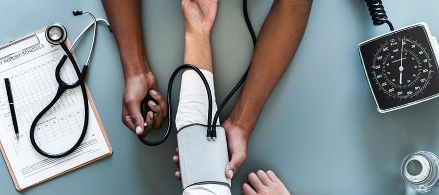 Doctor's hands mesuering blood presure of a patient