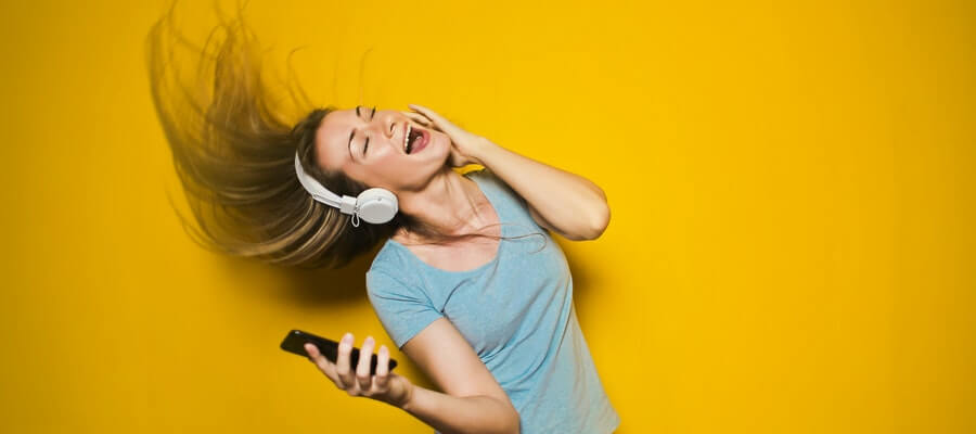 Young woman listening to music with phone and headset